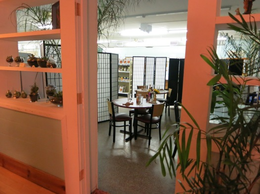 Wild Greens stakes out some turf in the neighboring co-op for expanded seating.